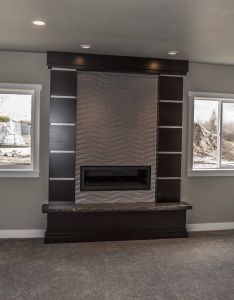 This basement family room has  lot of natural light the fireplace and windows make also rh pinterest