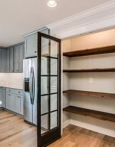 This traditional kitchen optimizes its space using  built in pantry with glass doors and stacked salvaged wood shelving dream book designs also rh pinterest