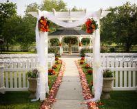 garden gazebo wedding ceremony aisle tulle flowers fabric ...
