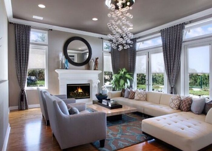 Neutral tone living room hard wood floors with fireplace also