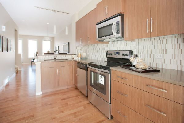 Open Concept L-shaped Kitchen With Stainless Steel
