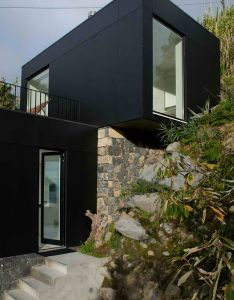 Hillside ruins turned modern black and white residence designs  ideas on dornob contemporary house pinterest architects architecture also rh in