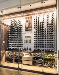 Modern custom reach in wine cellar featuring the Cable ...