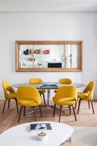 A Florence Knoll Oval Table and 6 Saarinen Executive ...