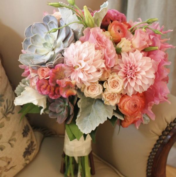 Coral bouquet with dahlias ranunculus and succulents by