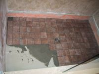build the shower floor first, including the floor tile