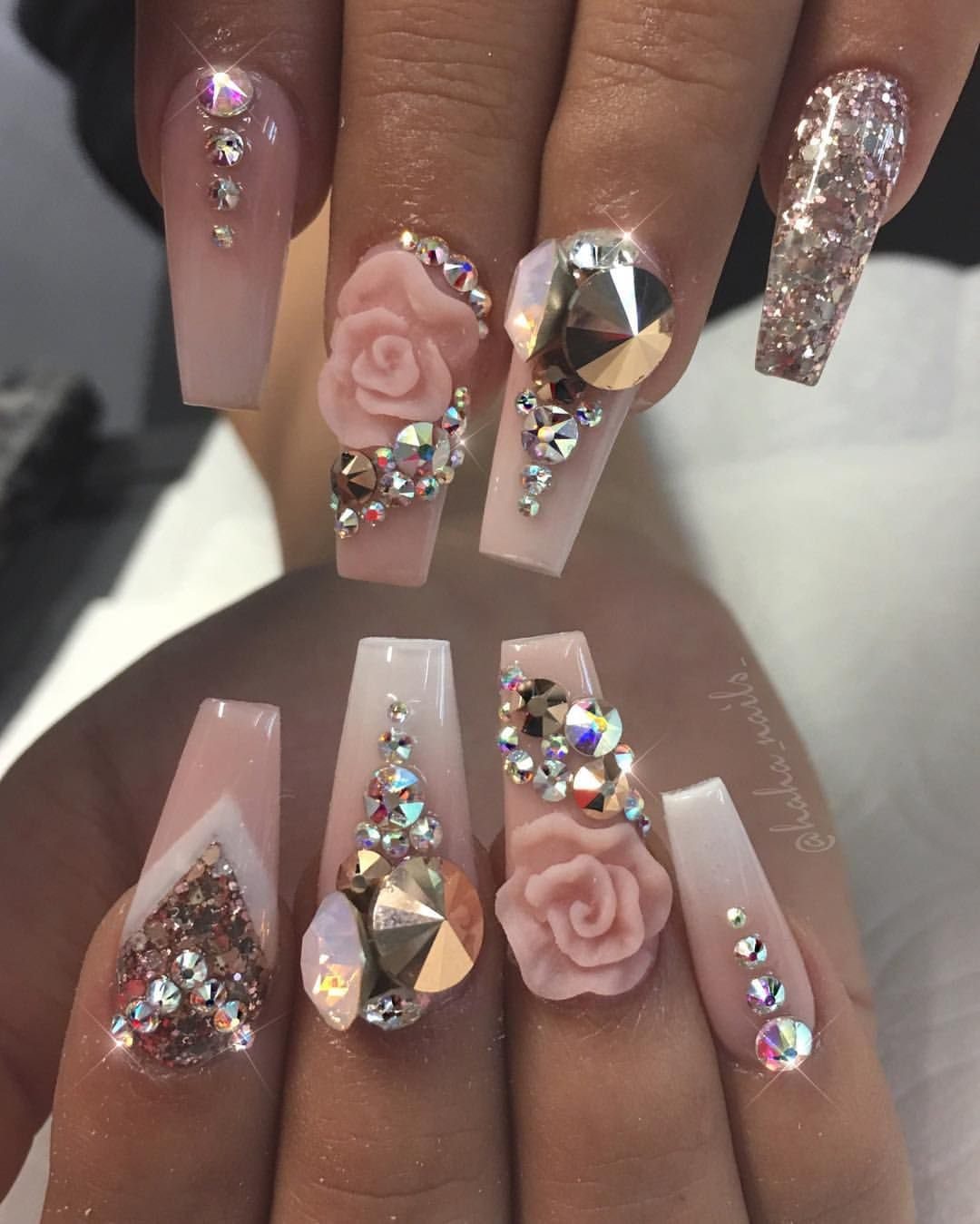 Light pink nails with 3D rose design and lots of gems