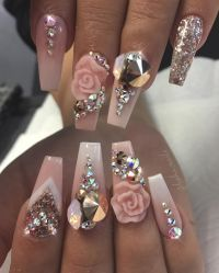 Light pink nails with 3D rose design and lots of gems ...
