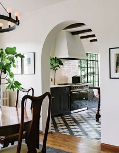 Patterned tile floors in the kitchen black white and gold beams also inspired by rh pinterest