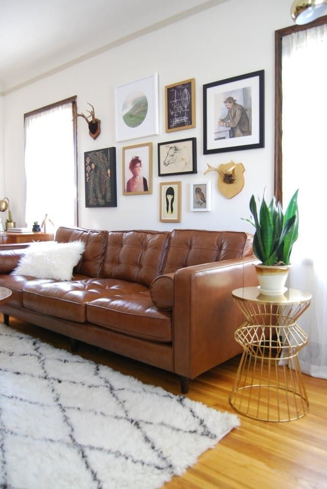 Over the sofa gallery wall love leather tufted as well also perfect placement living rooms that nailed hanging art above rh pinterest