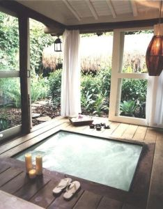 Future home spa tub with sliding glass doors to garden uxua casa hotel in brazil great idea have  hot porch also indoor big windows that open outside rh pinterest