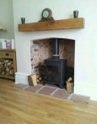 loving the simplicity of wood burner and wooden beam above ...