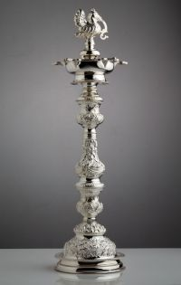 A skillfully crafted silver lamp...   Every cloud has a ...