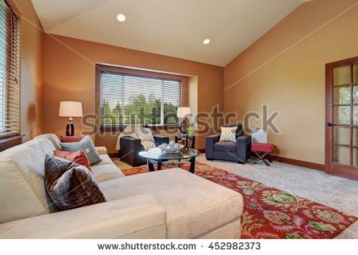 Cozy living room with high vaulted ceiling and mocha walls comfortable sofa set pillows also