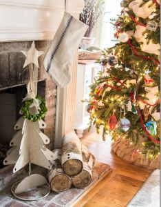 Holiday decorations for the fireplace mantel love that grain sack stocking great christmas decorating ideas inside this post also rh pinterest