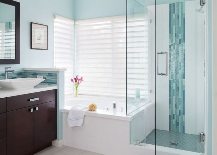 The turquoise glass tiles create  stunning look against white tile walls remodeling ideasbathroom also
