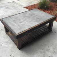Custom natural concrete inlaid top coffee table with a ...