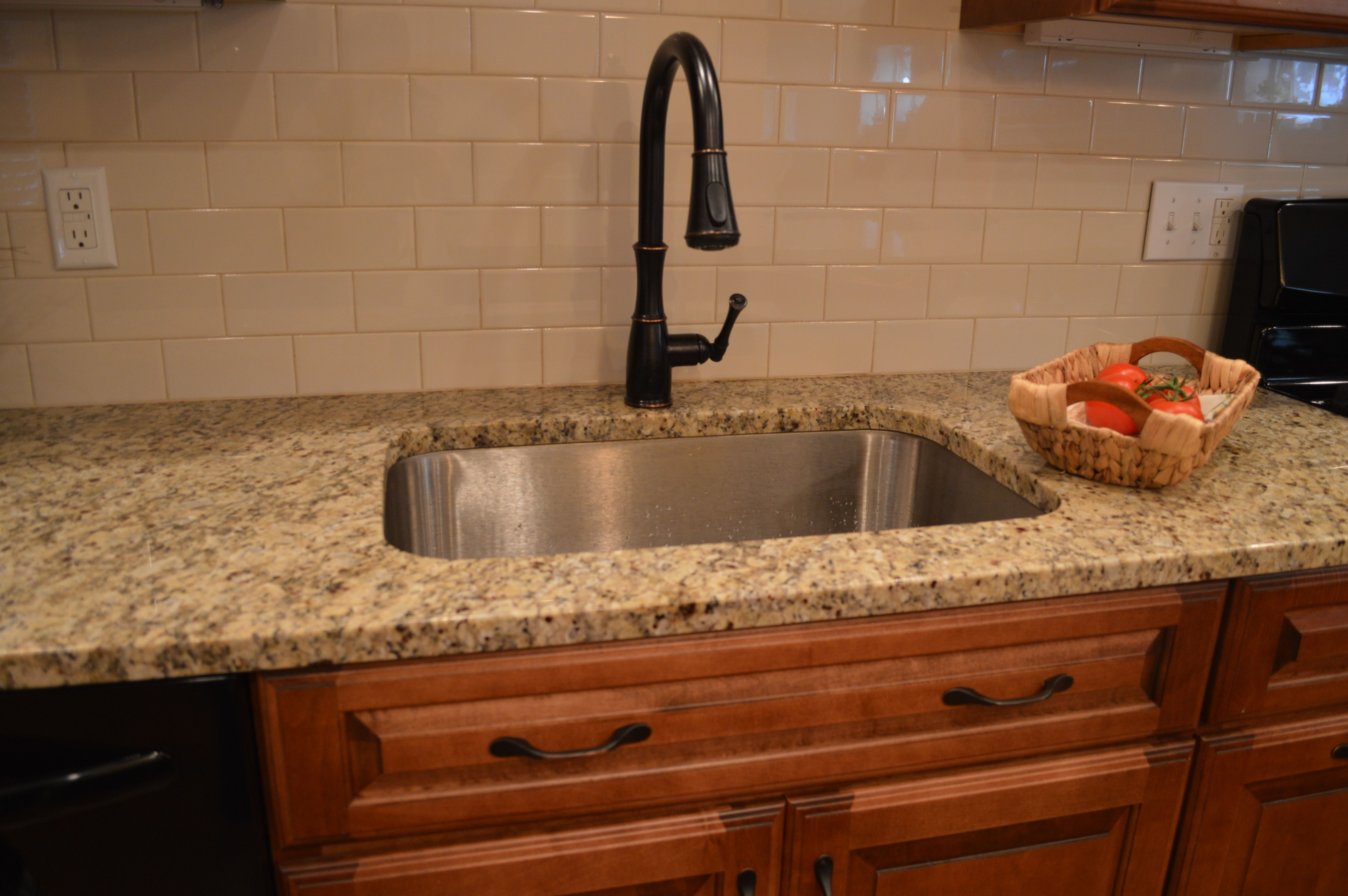 kitchen sink with backsplash carpenter cabinet small design ideas subway tiles