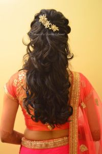 Indian bride's reception hairstyle by Swank Studio. Curls ...
