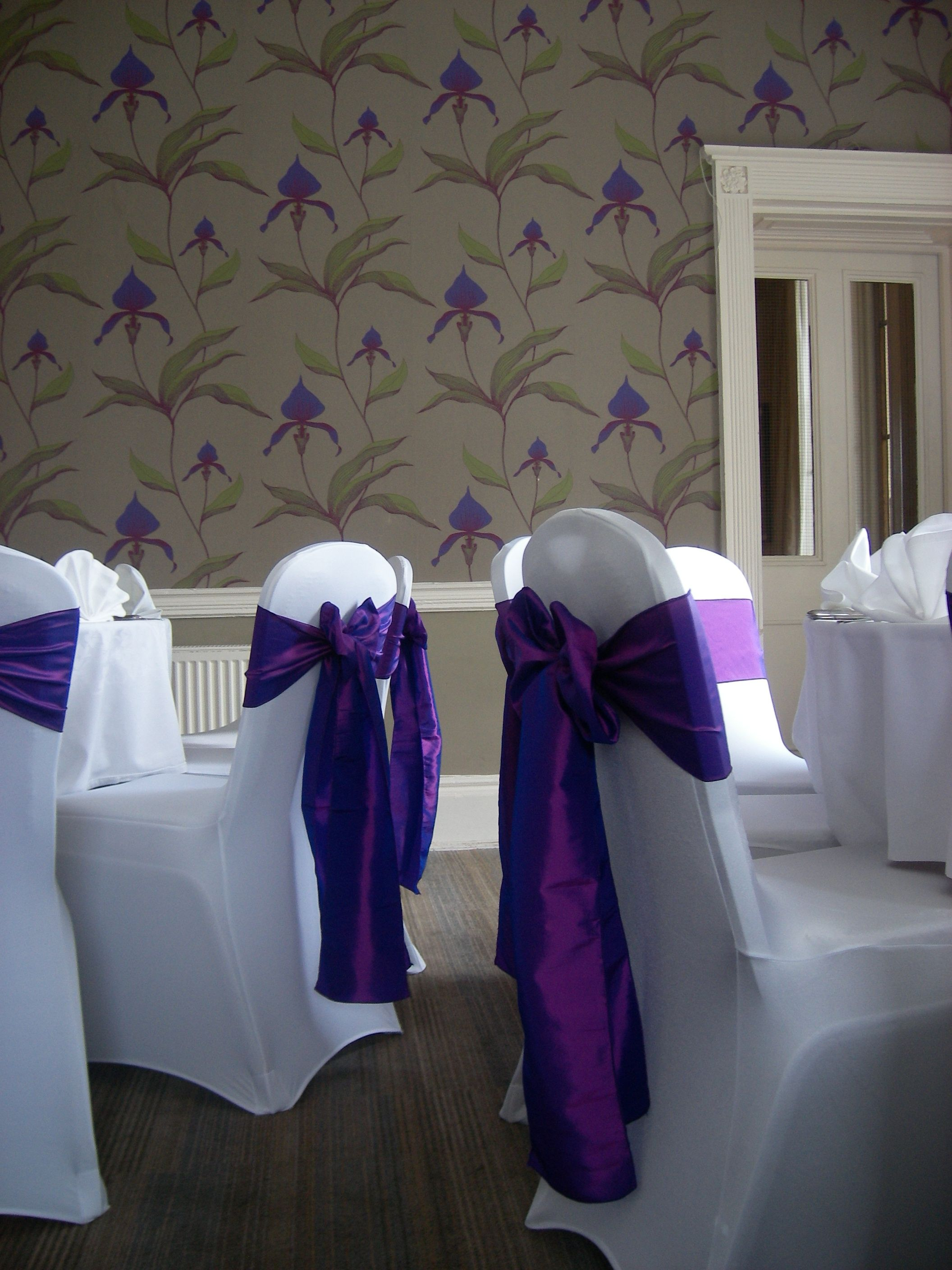 purple chair sashes for weddings leather and a half rocker recliner sweeney hall hotel dressed with white covers