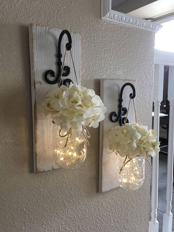 This is  beautiful set of mason jar wall sconces it includes two hanging jars and flowers the sconce measures tall wide also rh pinterest