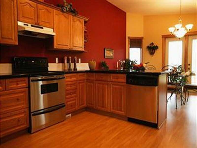 orange kitchens with cherry cabinets and stainless steel
