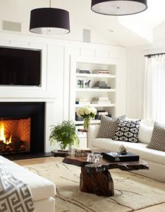 Pefect way to have  tv over fireplace designers nightmare the black shade light fixtures make it look as belongs there also beautiful coffee table home sweet   pinterest drum rh