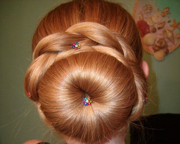 The Fluffy Sock Bun Is Surrounded By Thick Braids A Neat Formal