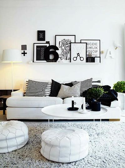 Love the layered art shelf in this modern black and white living room you can add different colored accessories with changing seasons while ke  also rh pinterest
