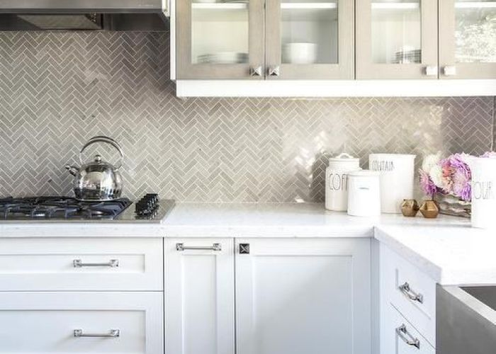 White kitchen cabinets with gray framed glass doors also
