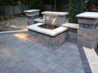 Beautiful waterfall and raised patio using Unilock brick ...