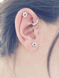 Piercings. Double forward helix with hoop piercings ...