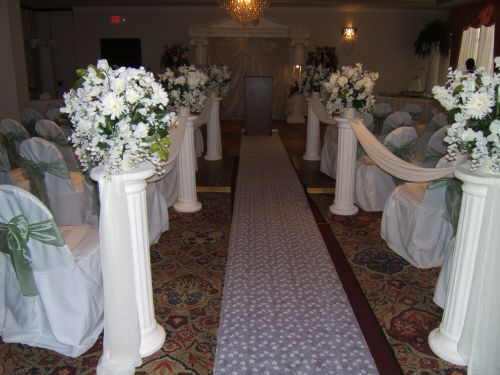 Beautiful White Pillars, Topped With Gorgeous Arrangements