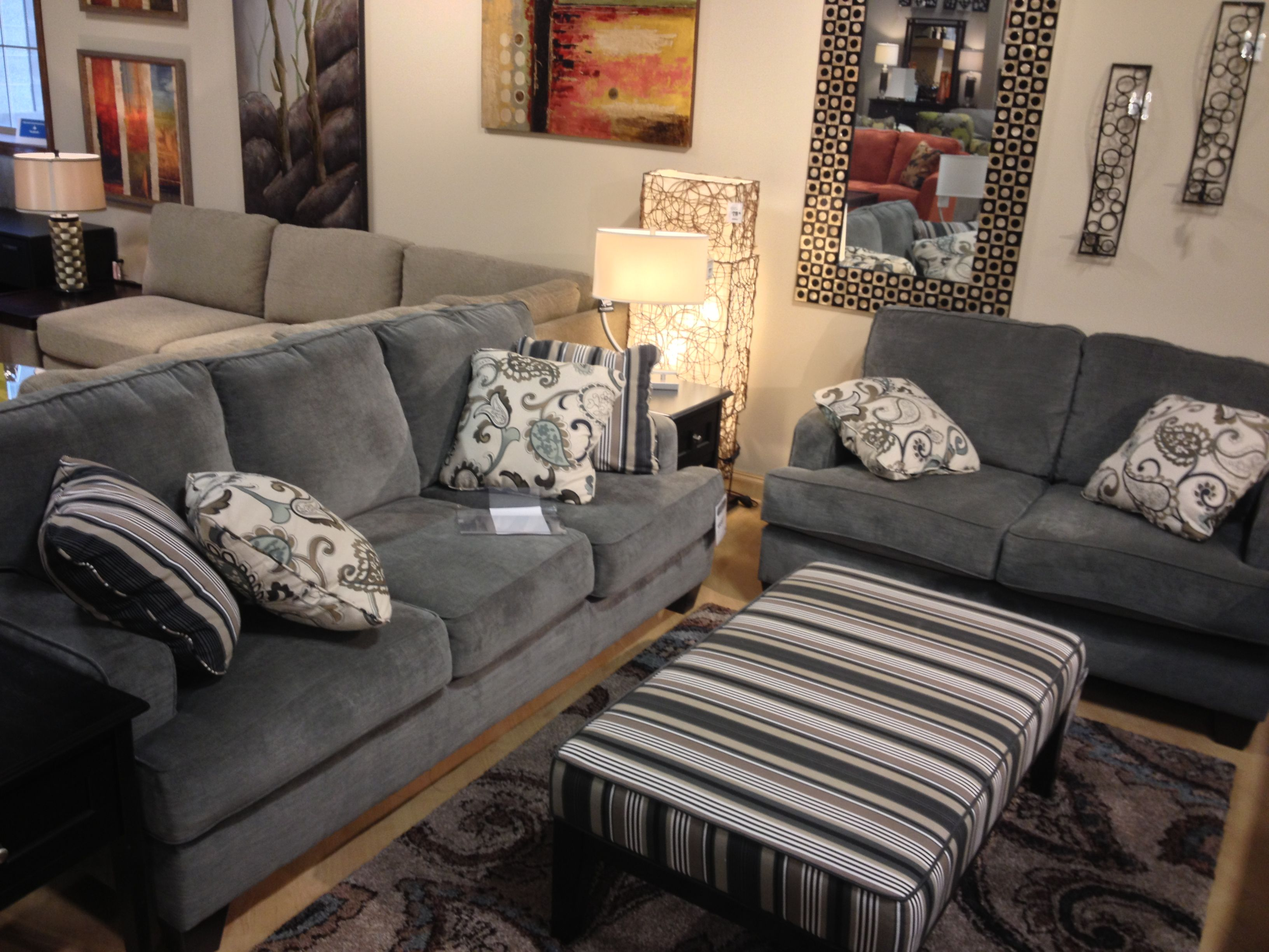 navasota charcoal sofa ashley furniture thomas the tank engine flip out bed yvette steel couch and loveseat at