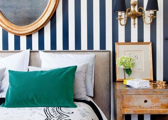 never tire of stripes stripe wallpaper or paint in the bedroom love gold mirror too against navy also decor option everything distressed