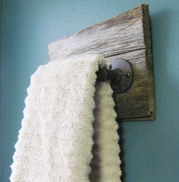 This rustic hand towel holder is handmade using salvaged
