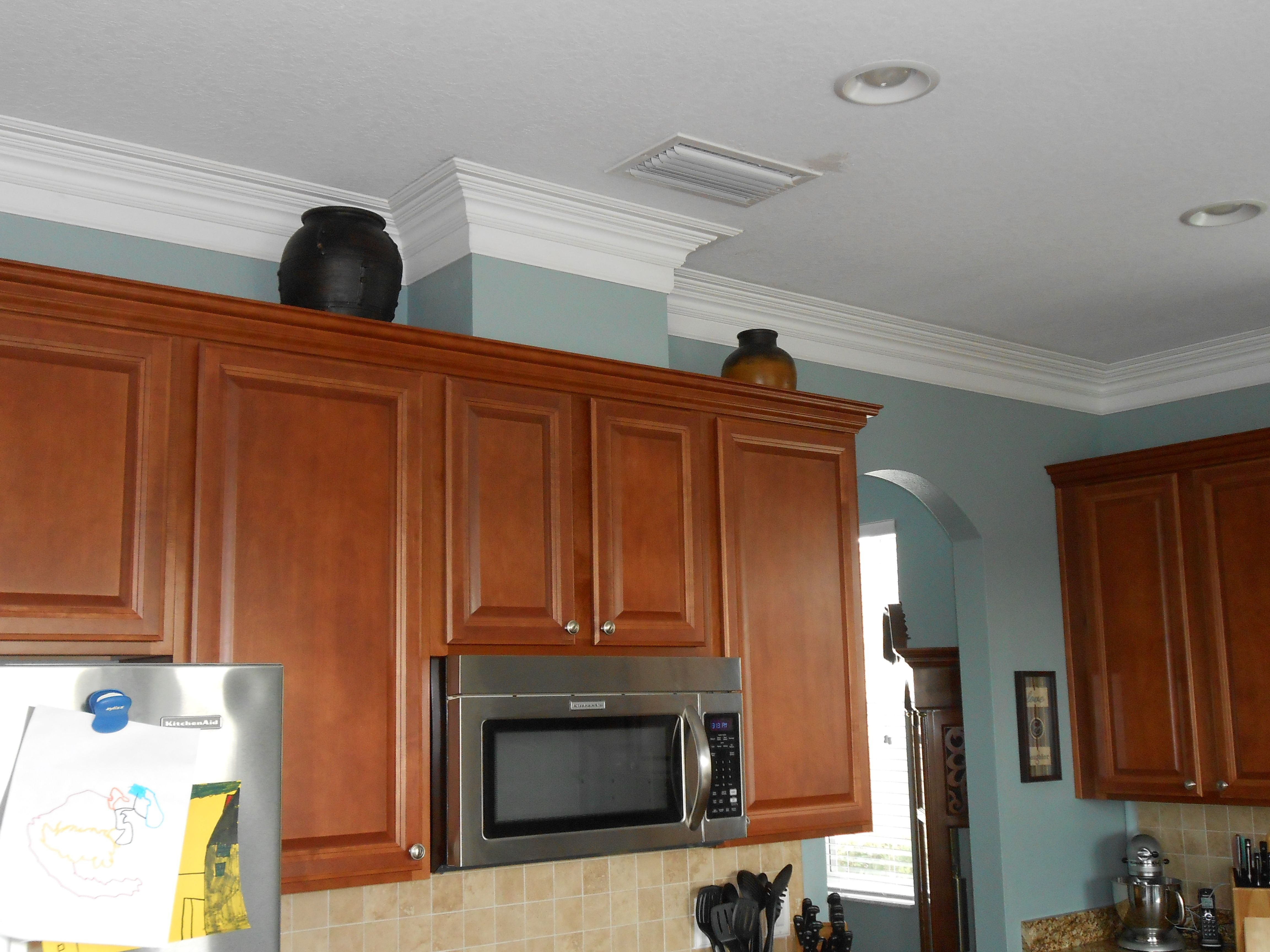 molding on top of kitchen cabinets faucets grohe crown work if the have a gap