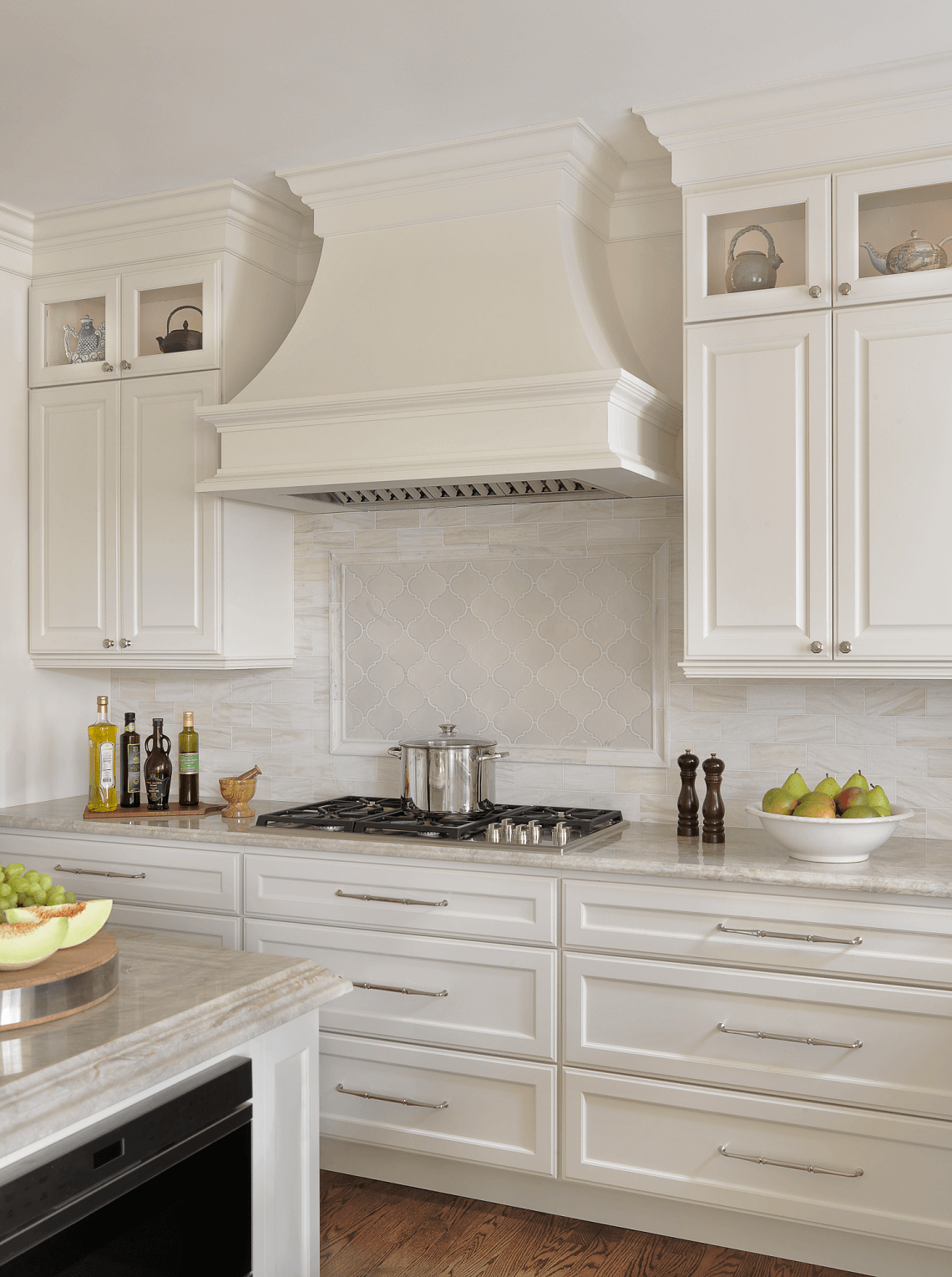This traditional kitchen renovation paired custom white