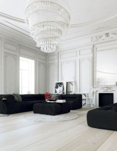 Parisian apartment white sitting room with black furniture sofas and ottoman chandelier mouldings wood floor also wide plank floors matching pieces living rh pinterest