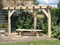 Hand built corner kit form pergola in green oak ...