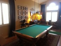 Formal living/dining rooms are often better used for pool
