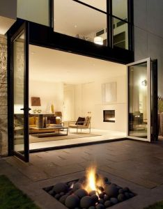 Accordion door living room with fire pit patio completely loving this home interior decor design also love the integrated outdoor pinterest rh