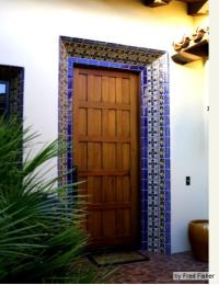 Mediterranean tile design, tile door trim, blue tile ...