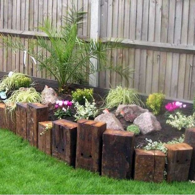 Rustic Softwood Sleeper Used To Create A Plant Border Garden