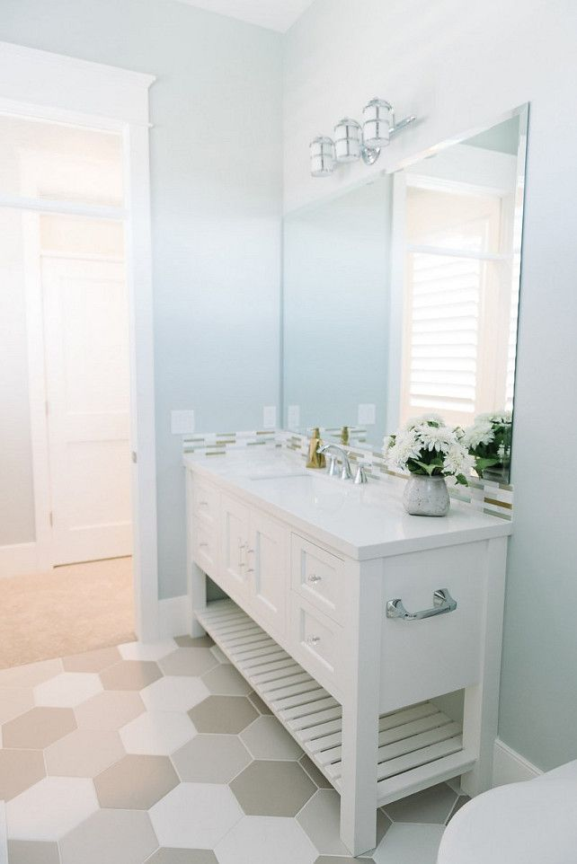 Bathroom Light blue bathroom with large hex floor tiles hexbfloortile Millhaven Homes