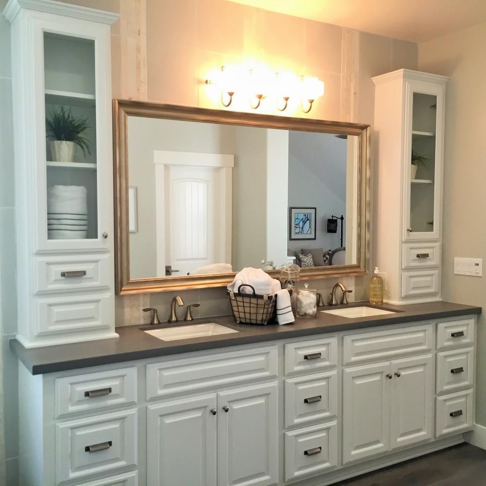 A large white vanity with double sinks provides plenty of space for two in this transitional
