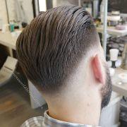 slicked haircut