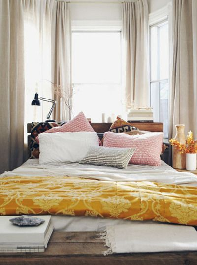Wooden bedframe patterned pillows yellow blanket bench curtained windows light bedroom decorbedroom also rh pinterest