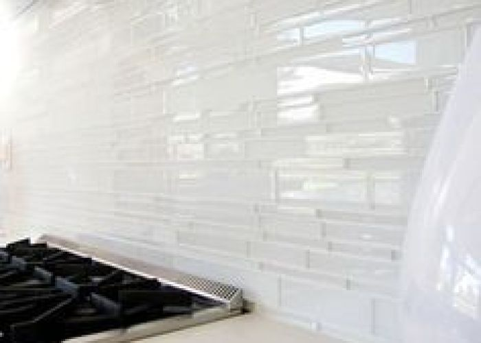 Love this glass tile backsplash could paint watercolor style on wall and then put also