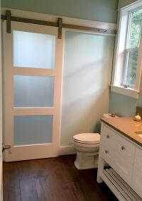 Frosted Glass Barn Door adds privacy to shower room on
